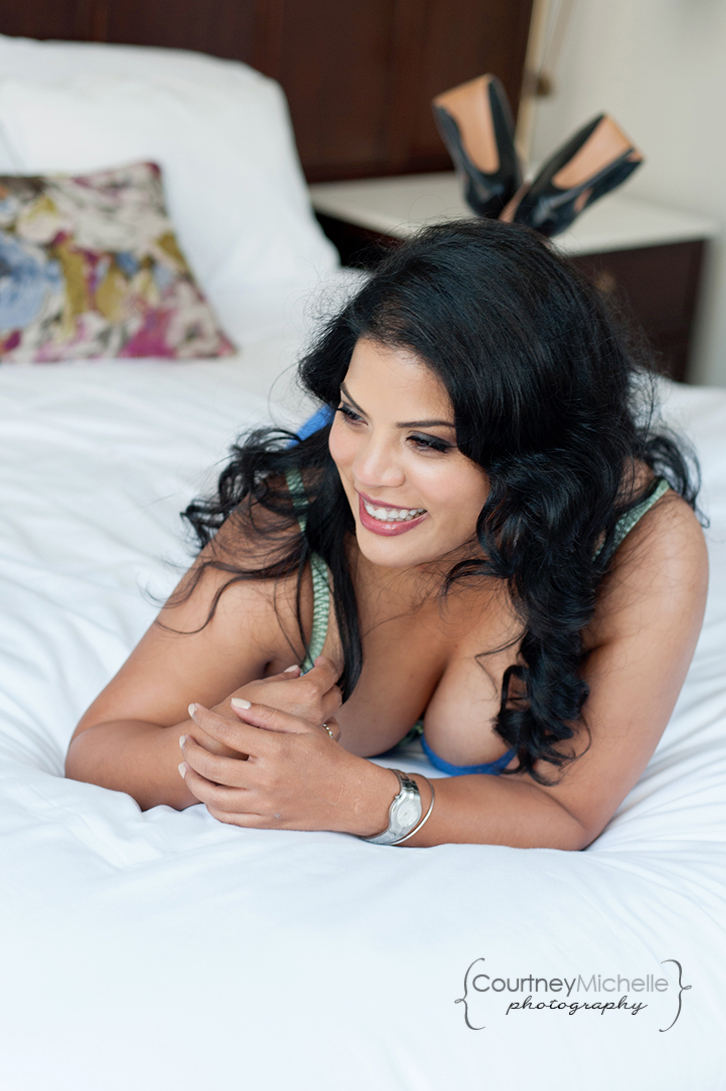 woman-laying-on-bed-laughing-and-looking-away-in-lingerie-chicago-boudoir-photography-by-courtney-laper.jpg
