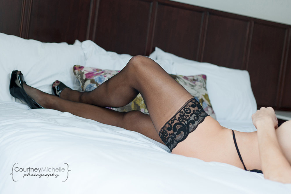 woman-legs-in-lingerie-and-heels-on-bed-chicago-boudoir-photography-by-courtney-laper.jpg