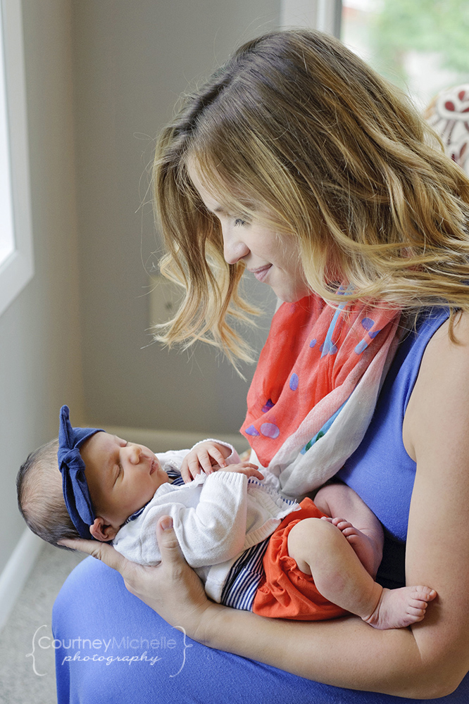 mom-holding-newborn-baby-girl-chicago-newborn-lifestyle-photography-by-courtney-laper.jpg