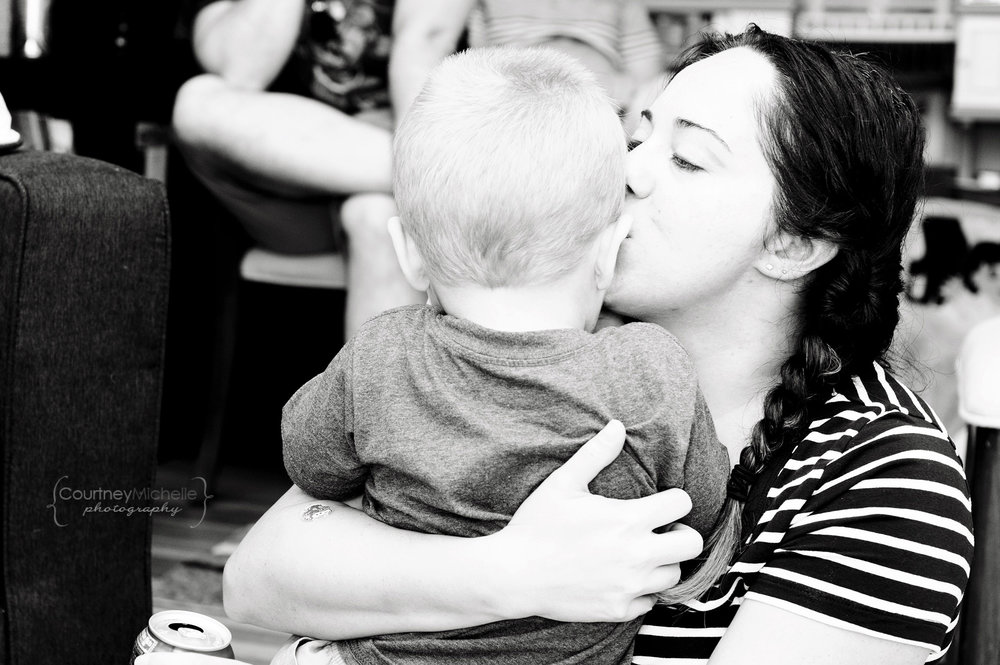 mom-kissing-son-lifestyle-photography-by-courtney-laper.jpg