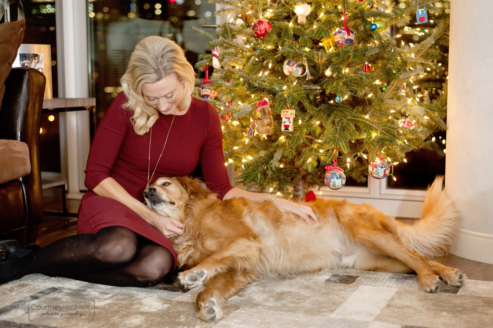 mom-petting-dog-in-front-of-christmas-tree-lifestyle-photography-by-courtney-laper.jpg