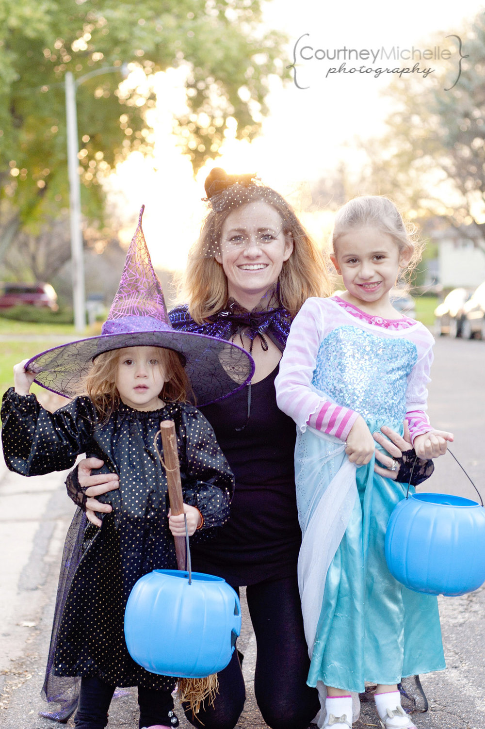 mom-and-daughters-laughing-in-halloween-costumes-lifestyle-photography-by-courtney-laper.jpg