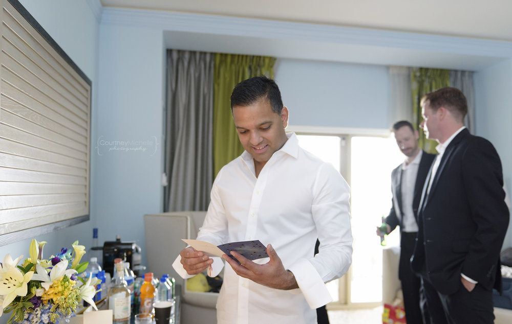 groom-reading-card-from-bride-grand-cayman-beach-wedding-photography-by-courtney-laper©CopyrightCMP-LeaAnneRaj-7446.jpg