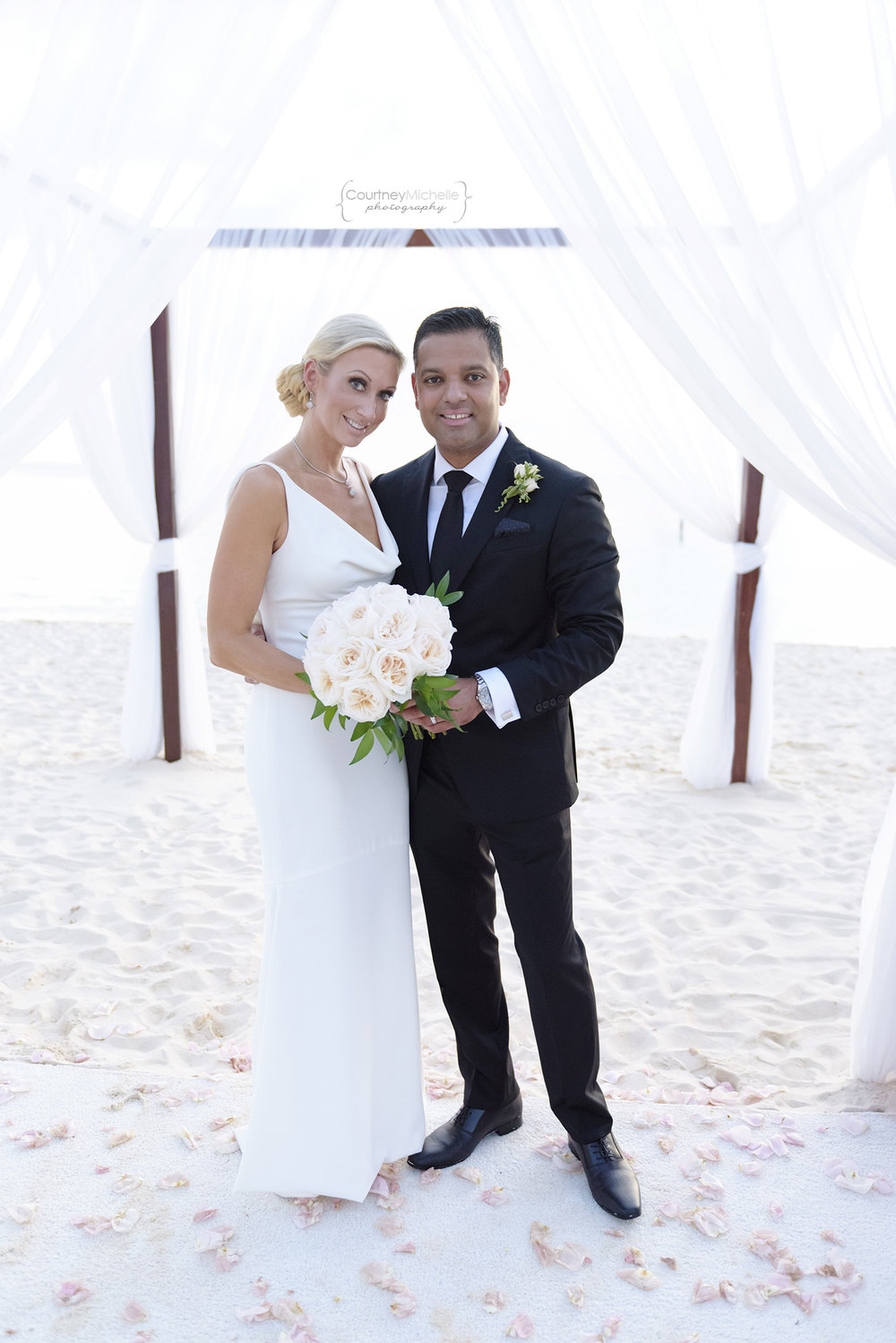 bride-and-groom-portrait-grand-cayman-beach-wedding-photography-by-courtney-laper©CopyrightCMP-LeaAnneRaj-8045.jpg