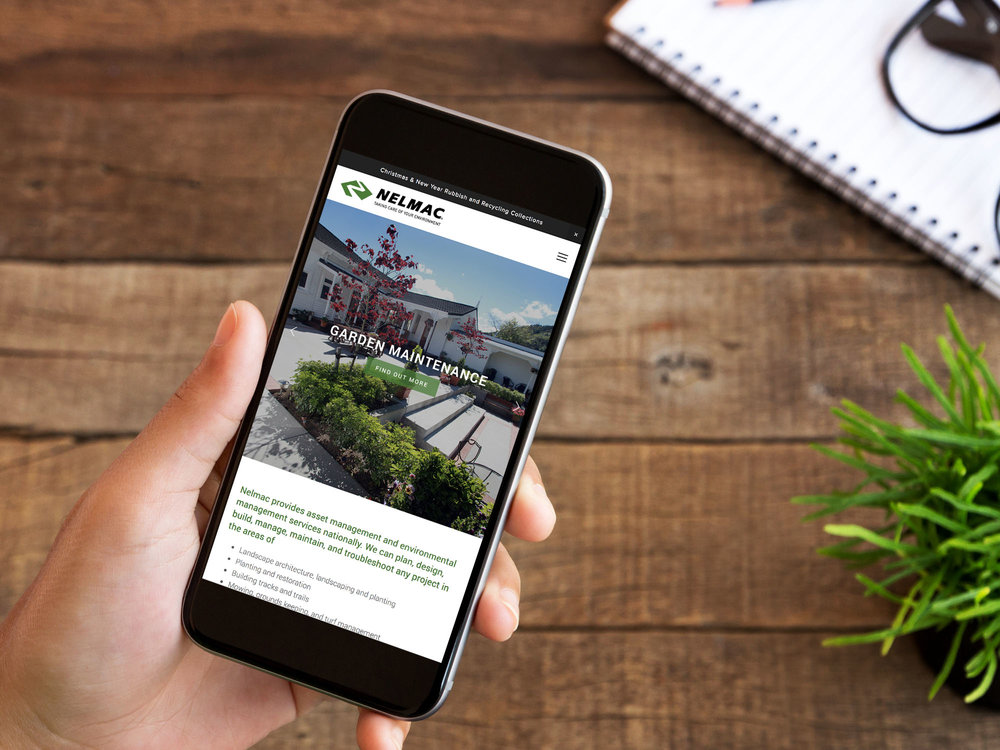 Hand Holding Clean Smartphone Mockup Nelmac.jpg