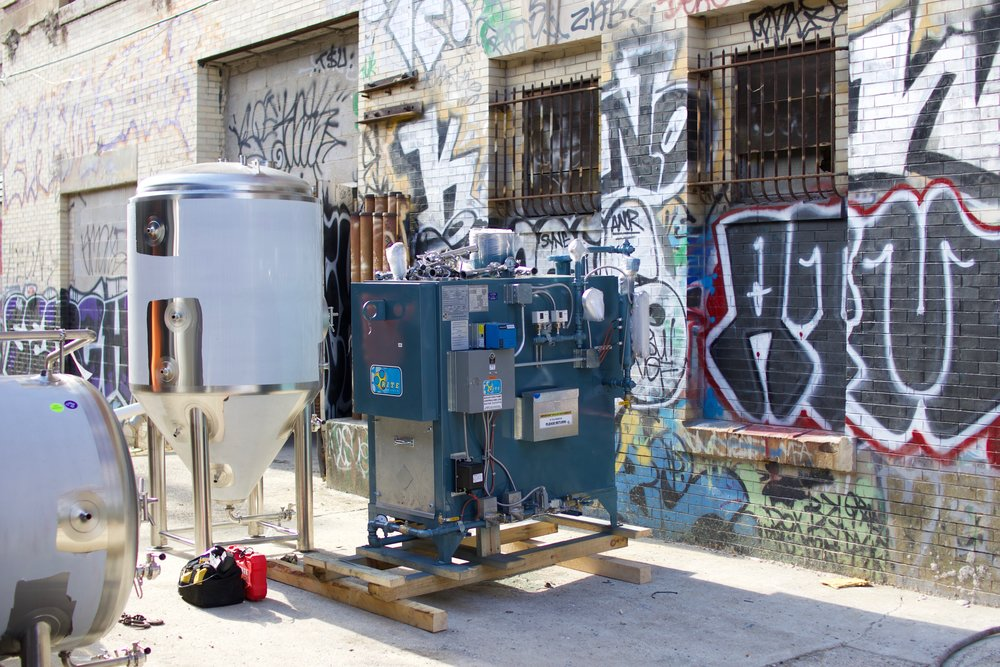 Our boiler and fermenter wait on our loading dock.
