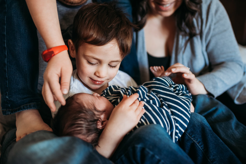 big-brother-holding-newborn-baby-Laura-Boggs-Photography.jpg