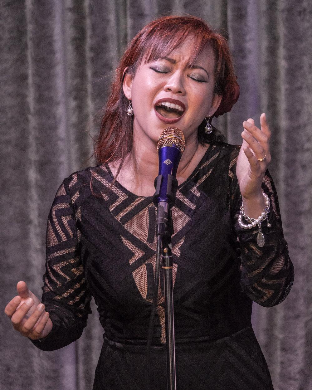 Singing with hands portrait.jpg