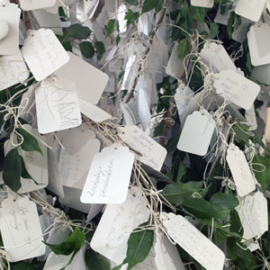 The Wish Tree has been a part of many exhibitions by Yoko Ono since the 1990s. People are invited to write their wish on a piece of paper and hang it to a tree branch