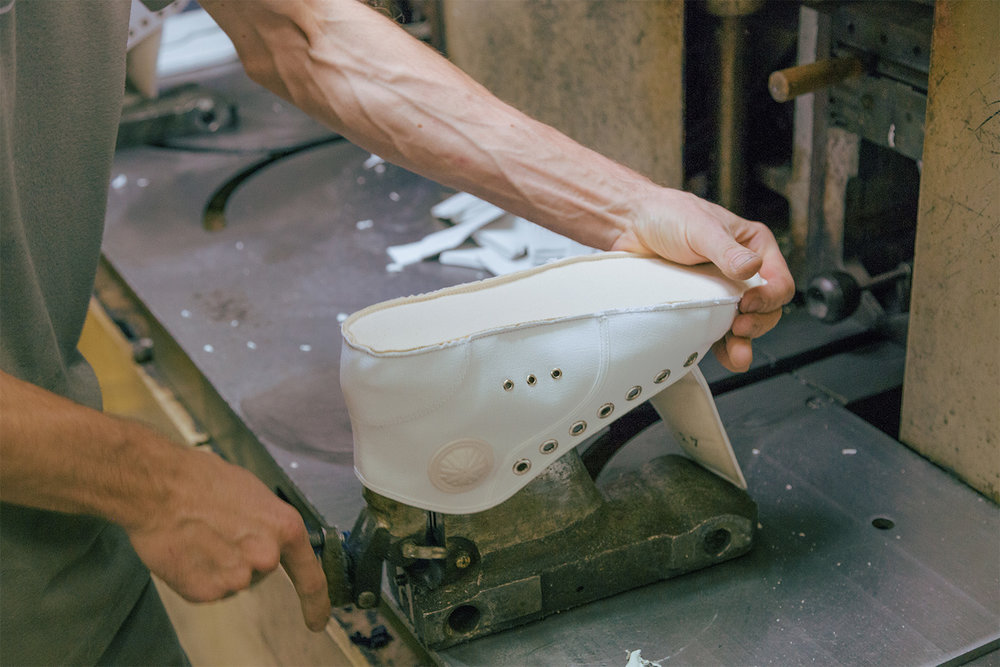 The shoe is mounted on a mold before the rubber is attached.