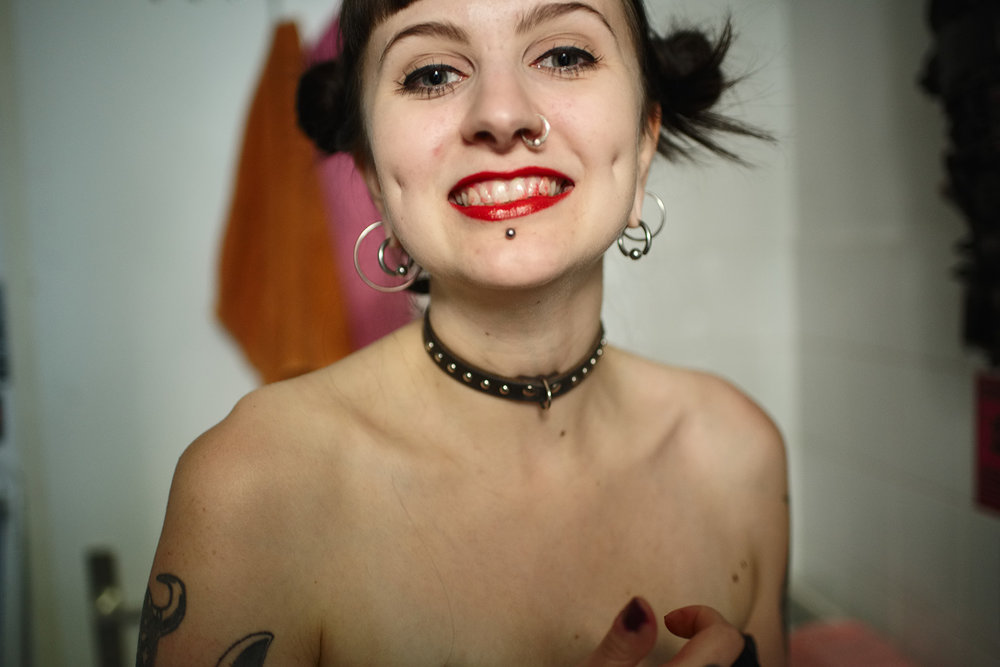 Iina wearing lipstick on her teeth, Berlin, 2016