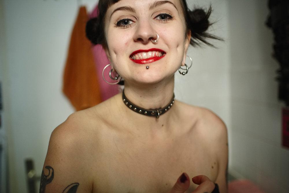 Iina wearing lipstick on her teeth, Berlin, 2016