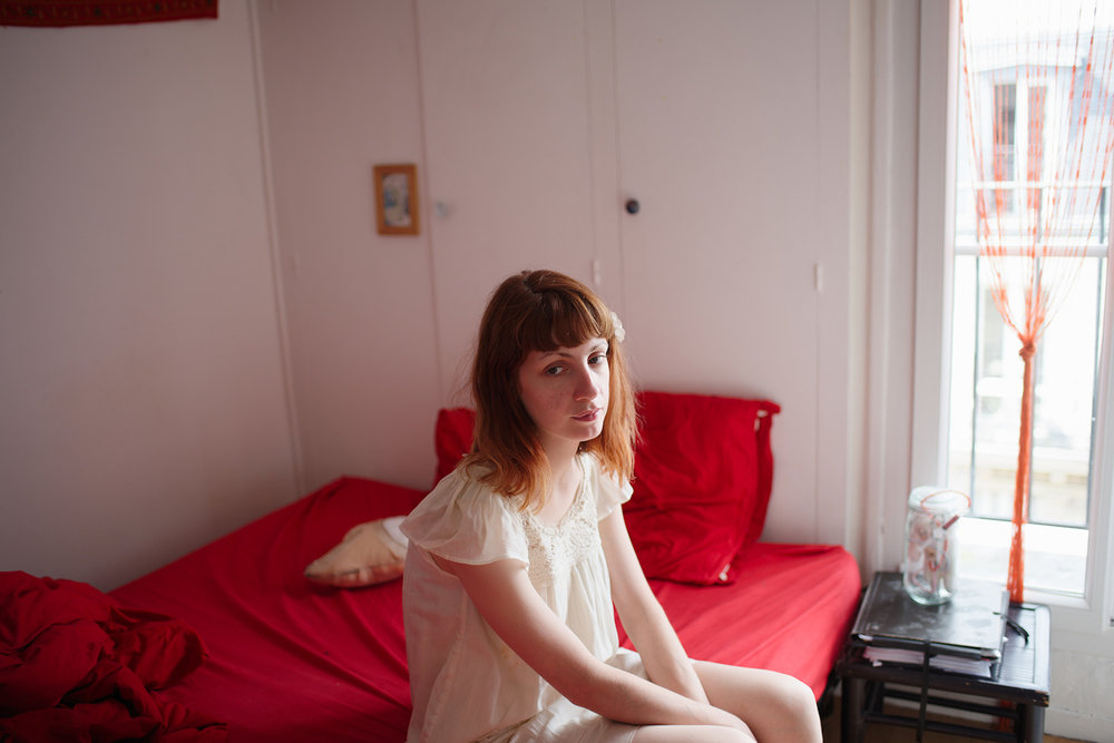 Rosane on her bed, Paris, 2016