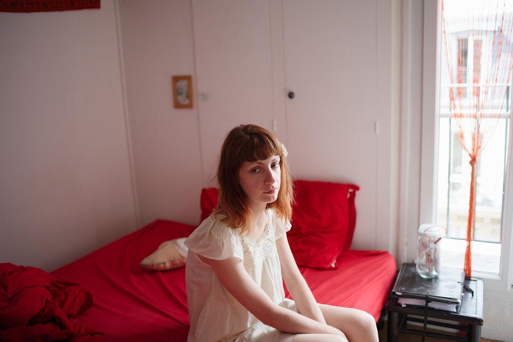 Rosane on her bed, Paris, 2016