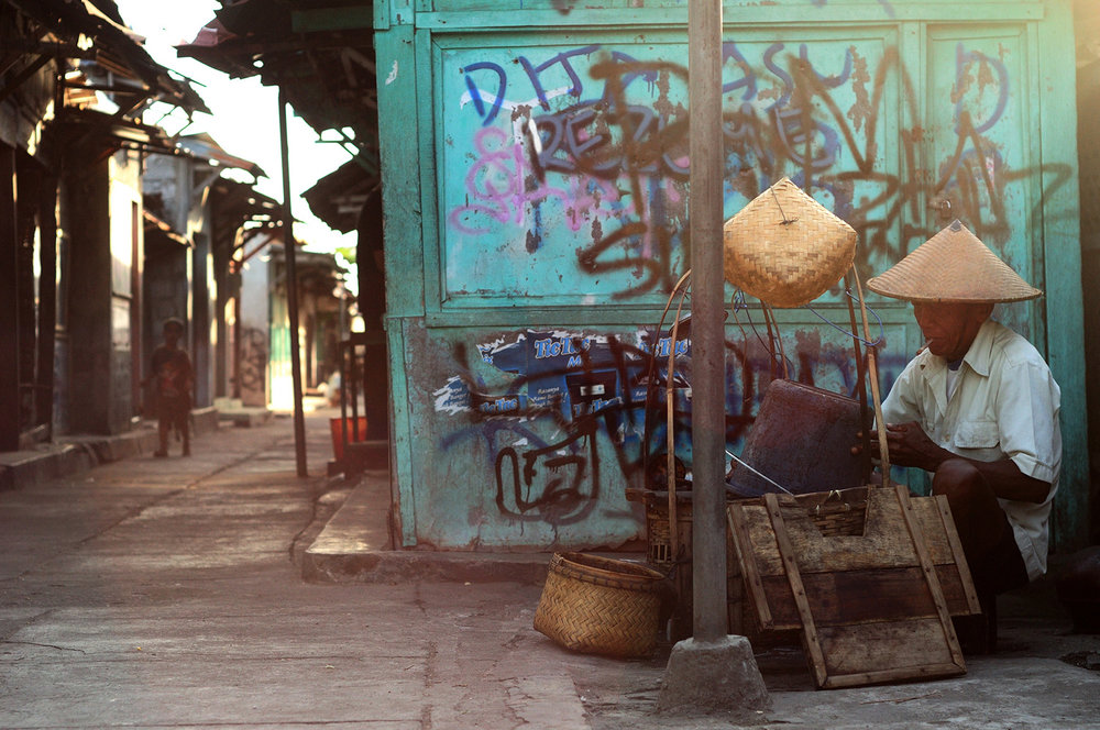 Man working in an alleyway  , Jogjakarta, Indonesia, 2012