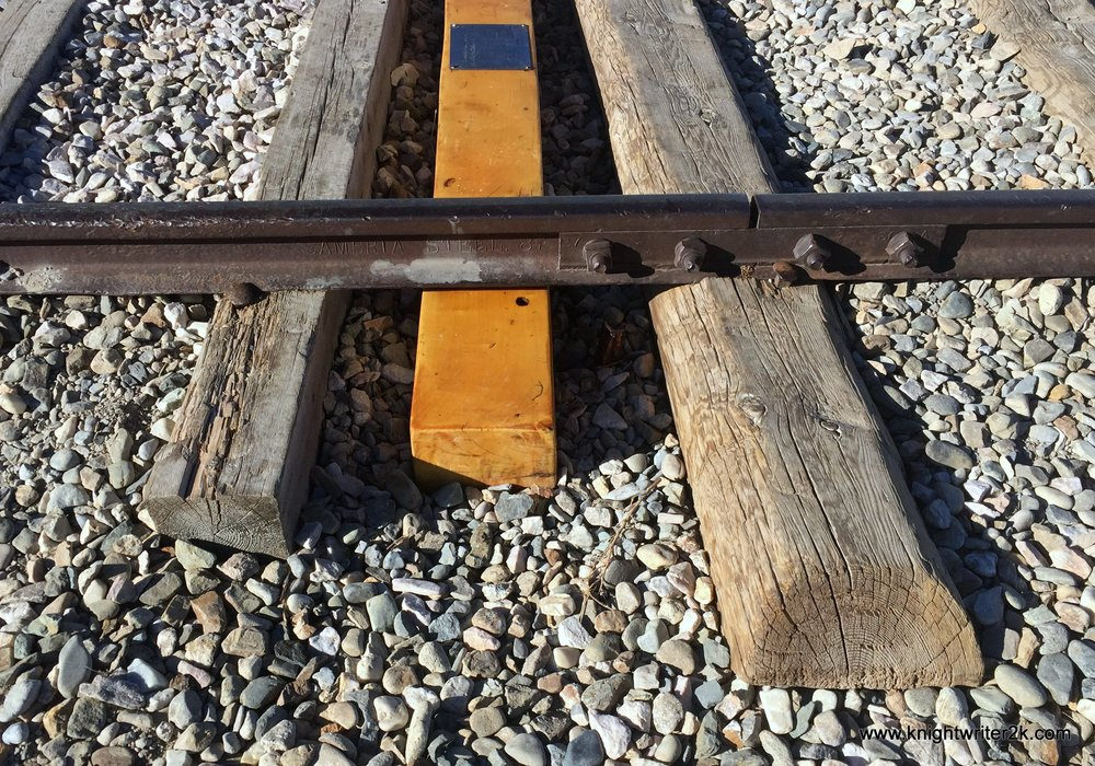 A golden tie commemorating the laying of the Golden Spike on May 10, 1869, flanked by a Central Pacific tie to the left and a Union Pacific tie to the right.  These are all replicas, by the way.  The line was decommissioned in the early 20th Century and the original metal was later reused for the WWII war effort.