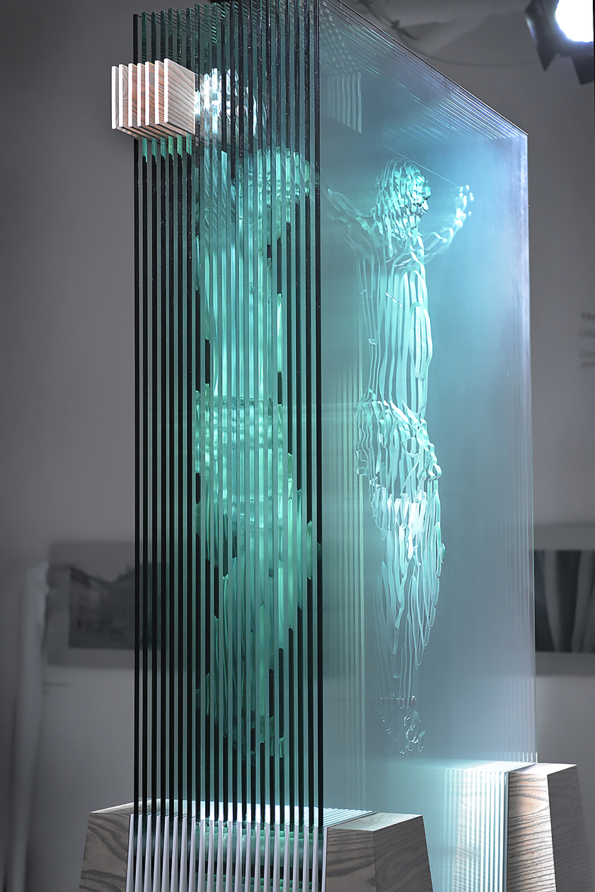 The  Hidden Face of God  glass sculpture, 10' tall, side view showing figure of redirected light on the left.
