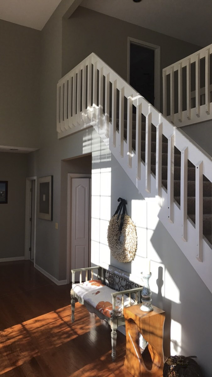Existing foyer and stairway.