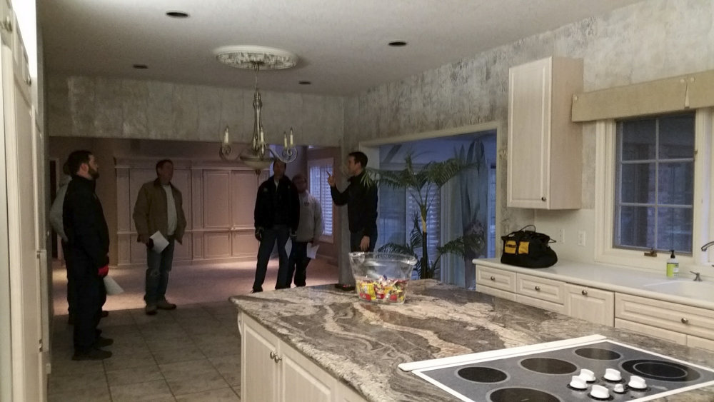 Kitchen before.  Discussing demolition plan.