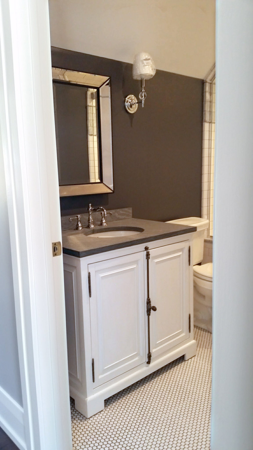 Bath vanity with sconces
