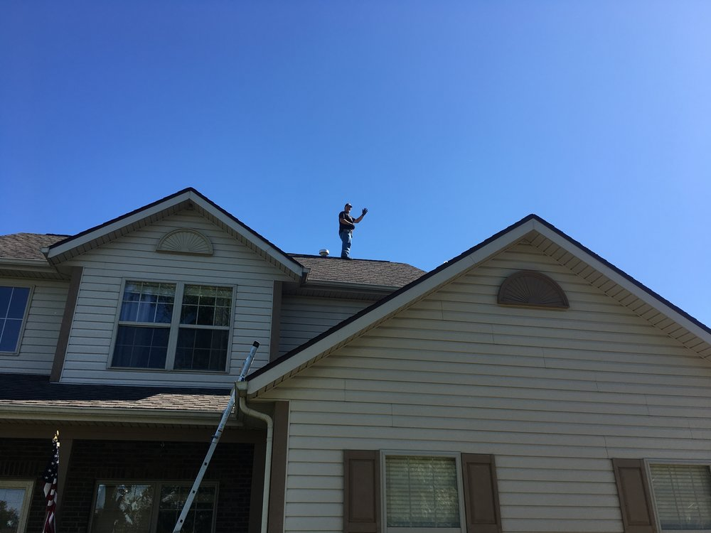 We get the ladders out at every Home Inspection to inspect the roof - (Safety is always considered)(Yes. I am waving at you in this image)