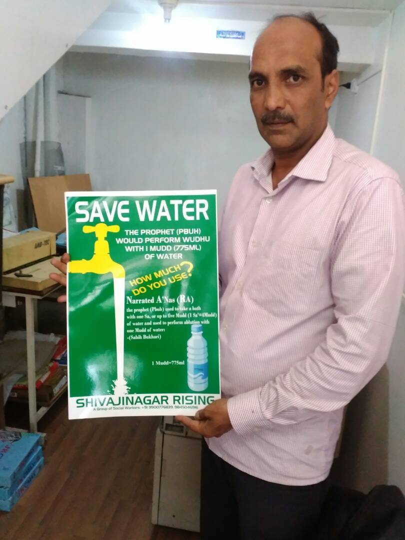 Sufiyan with the poster on water conservation