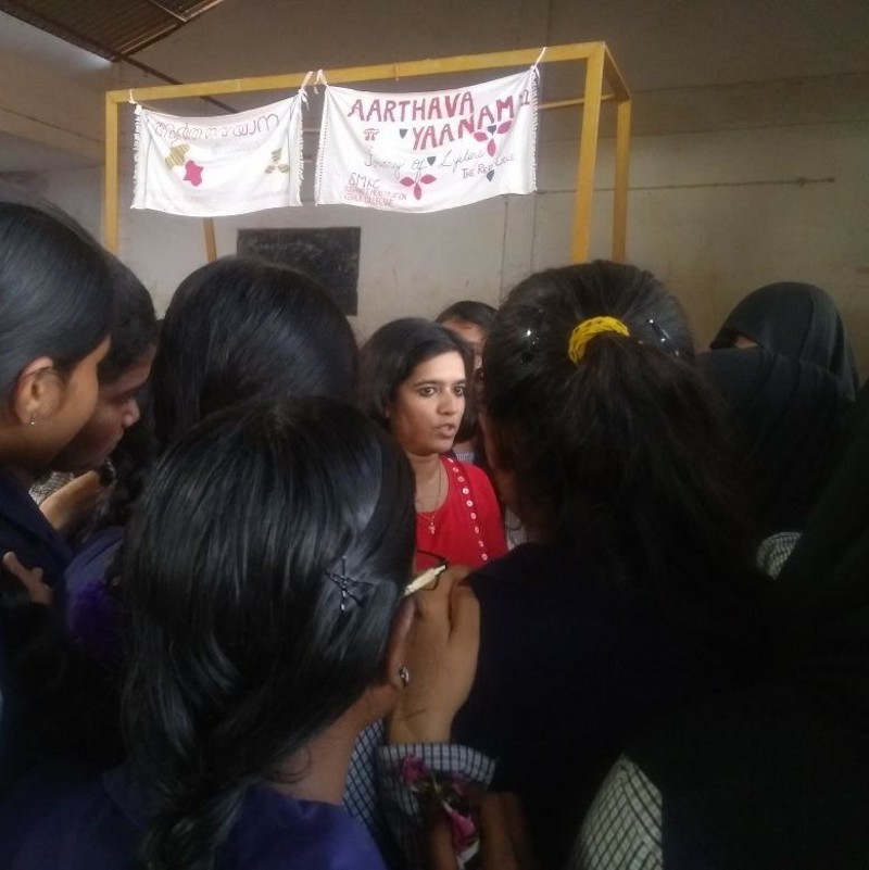 Kavya Menon interacts with students as part of Aarthava Yaanam. Photo credit: The Red Cycle/Facebook