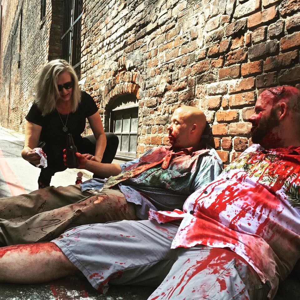 Makeup artist Debbie Helms Howell adding more blood!