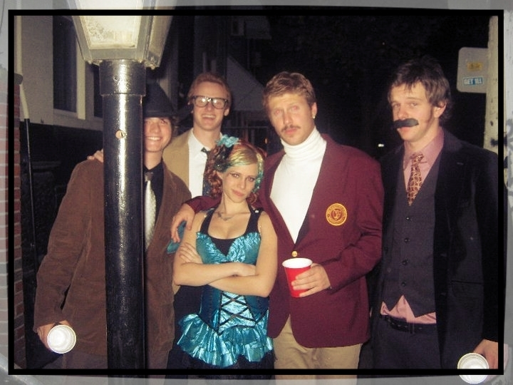 Me, freshman year at UArts, dressed as Icon, Ron Burgundy, red solo cup in hand, a singular hoop earring in my left ear, with my arm around a girl dressed as fairy. Her name was actually Pixie. Perhaps the only fact I remember from that night. It's a miracle I made it through the year.