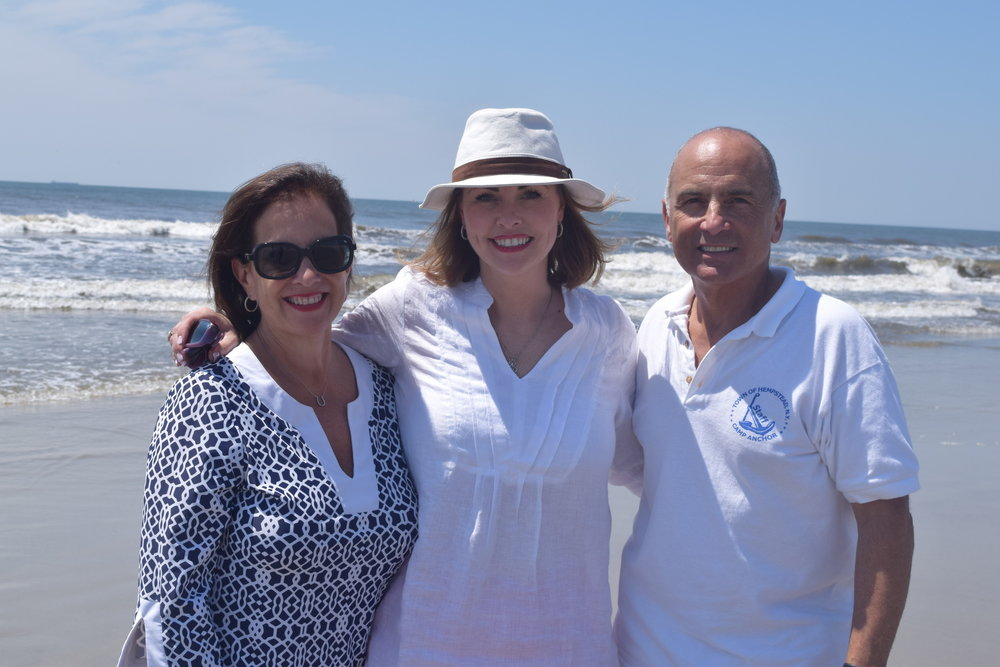 BCCA Executive Director Joanne Adams, far left, Town of Hempstead Councilwoman Erin King Sweeney and Camp ANCHOR Coordinator Joe Lentini helped unify the two nonprofits in Lido Beach on July 19.