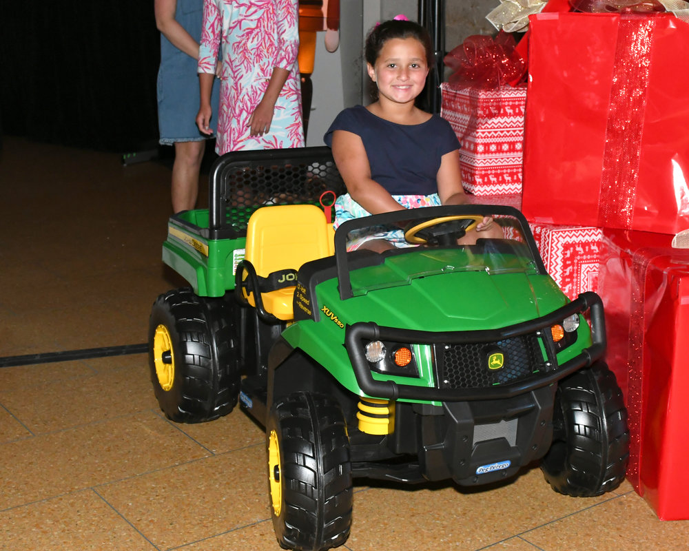 Siena Castellano-Javier's daughter riding one of the live auction items!.jpg