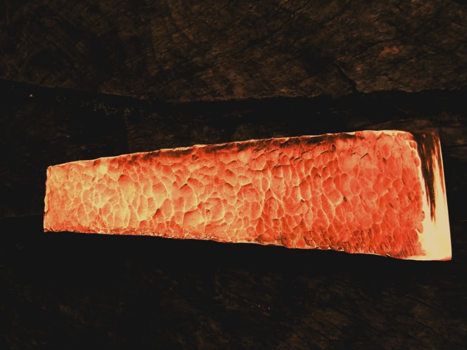 Ötzi's copper axe; a symbol of his tribal authority.