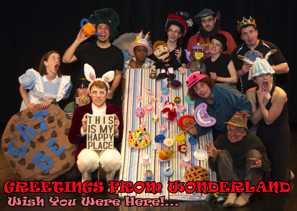 Left to Right (ish): Lindsay Sippel Eitzen (Giant Cookie), Darcey Giffin (Darth Vader Helmet), Chris George (Happy Place), Mark Palumbo (Teapot), Natalie Morgan (Birthday Cake Hat), Adrian Eitzen (Doctor Puppet), Andre Morin (Sequin Hat), Carolyn Lawrence (Bowler Hat), Luke Bramer (Crown), Lynne Griffin (Cheshire Cat Smile), Katie Leamen (Tea Cosy with Ears), Sean Sullivan (Plaid Fedora, but what's with the creepy hards?)