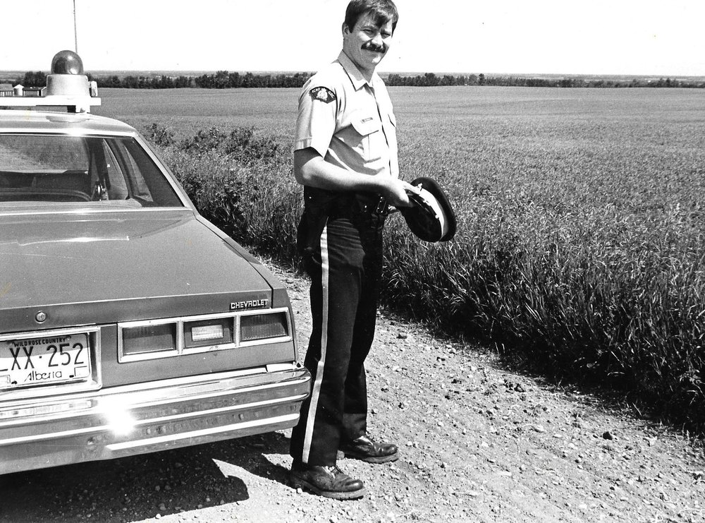 Constable Randy Leamen on patrol in Fort Saskatchewan, Alberta (1980)