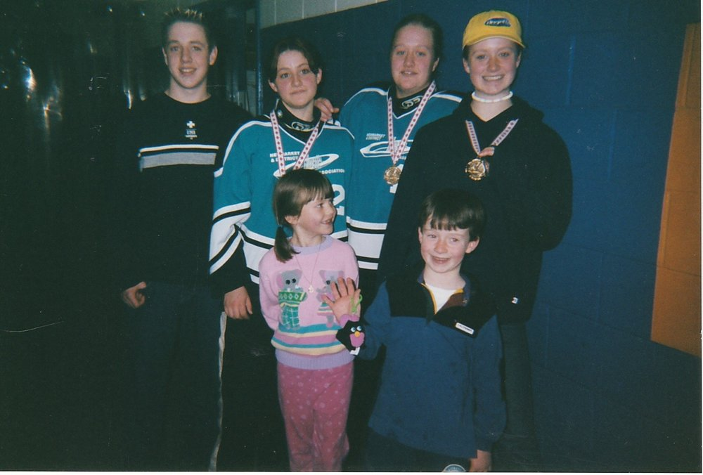 Cousins at a Ringette tournament. Left to right (back) Scott, Jennifer, Lindsey, Katie (front) Ashleigh, Travis.