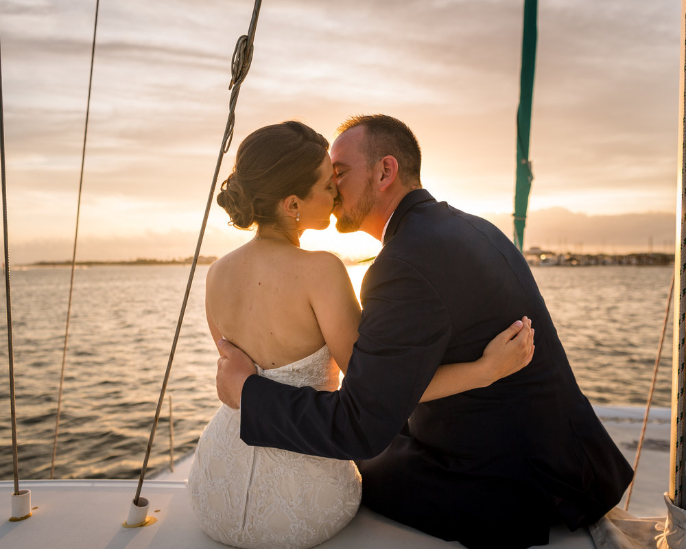 Sunset Sail-away Wedding Kiss