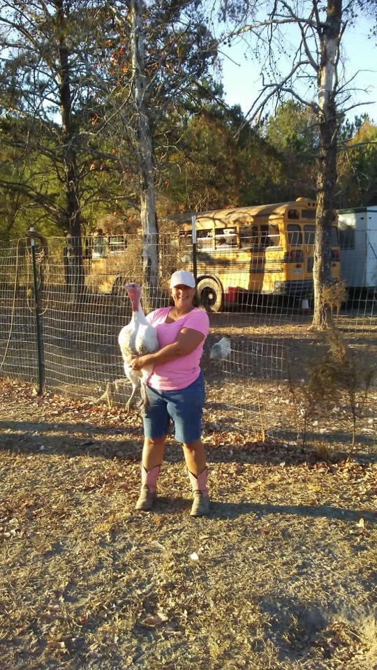 Michelle holding a turkey Morning Glory farms .jpg