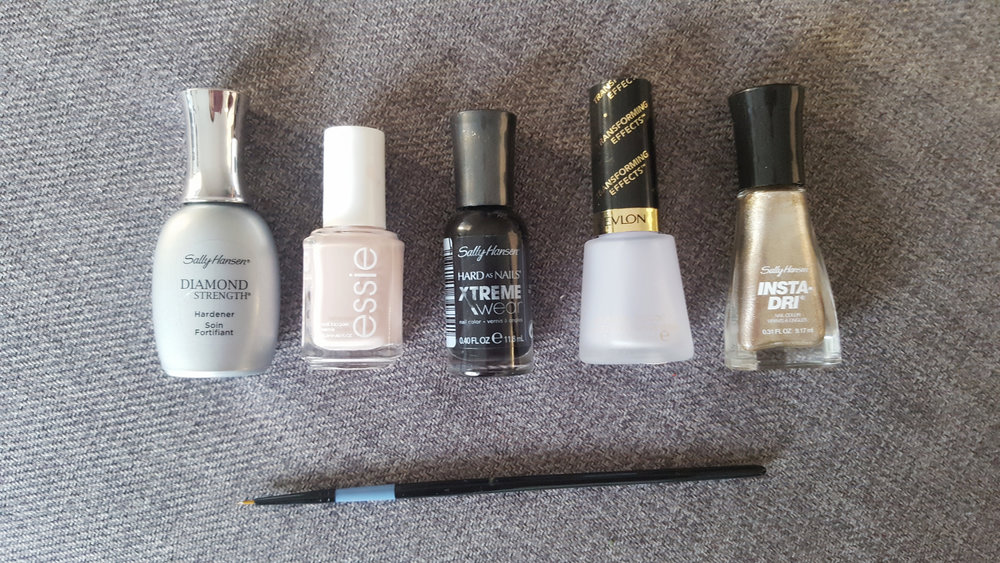 "Products used (from left to right): Sally Hansen Diamond Strength Base Coat, Essie ""Topless & Barefoot,"" Sally Hansen Hard as Nails ""Black Out,"" Revlon Matte Top Coat, Sally Hansen Insta-Dri ""Go For Gold""  You may use a brush or toothpicks for the leaf design application."