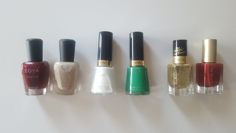 Here are some of my holiday colour picks (from left to right): Zoya PixieDust in Chyna, Zoya PixieDust in Godiva, Revlon Nail Enamel in Pure Pearl, Revlon Nail Enamel in Posh, L'Oreal Colour Riche Top Coat in The True Gold, L'Oreal Colour Riche in Red Tote.