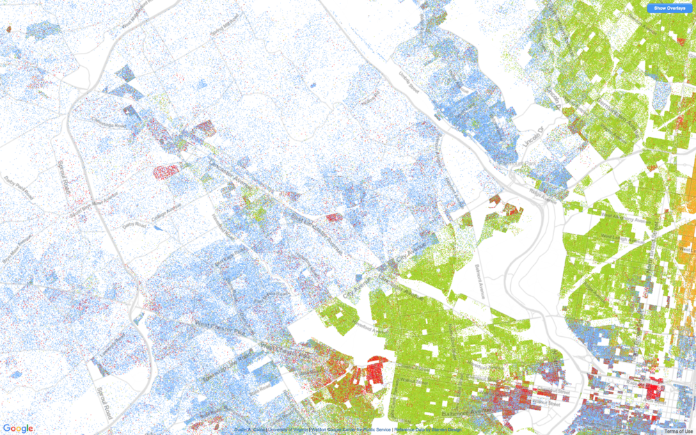 A map illustrating the segregation of greater Philadelphia. Each blue dot is a while person, each green dot a black person.