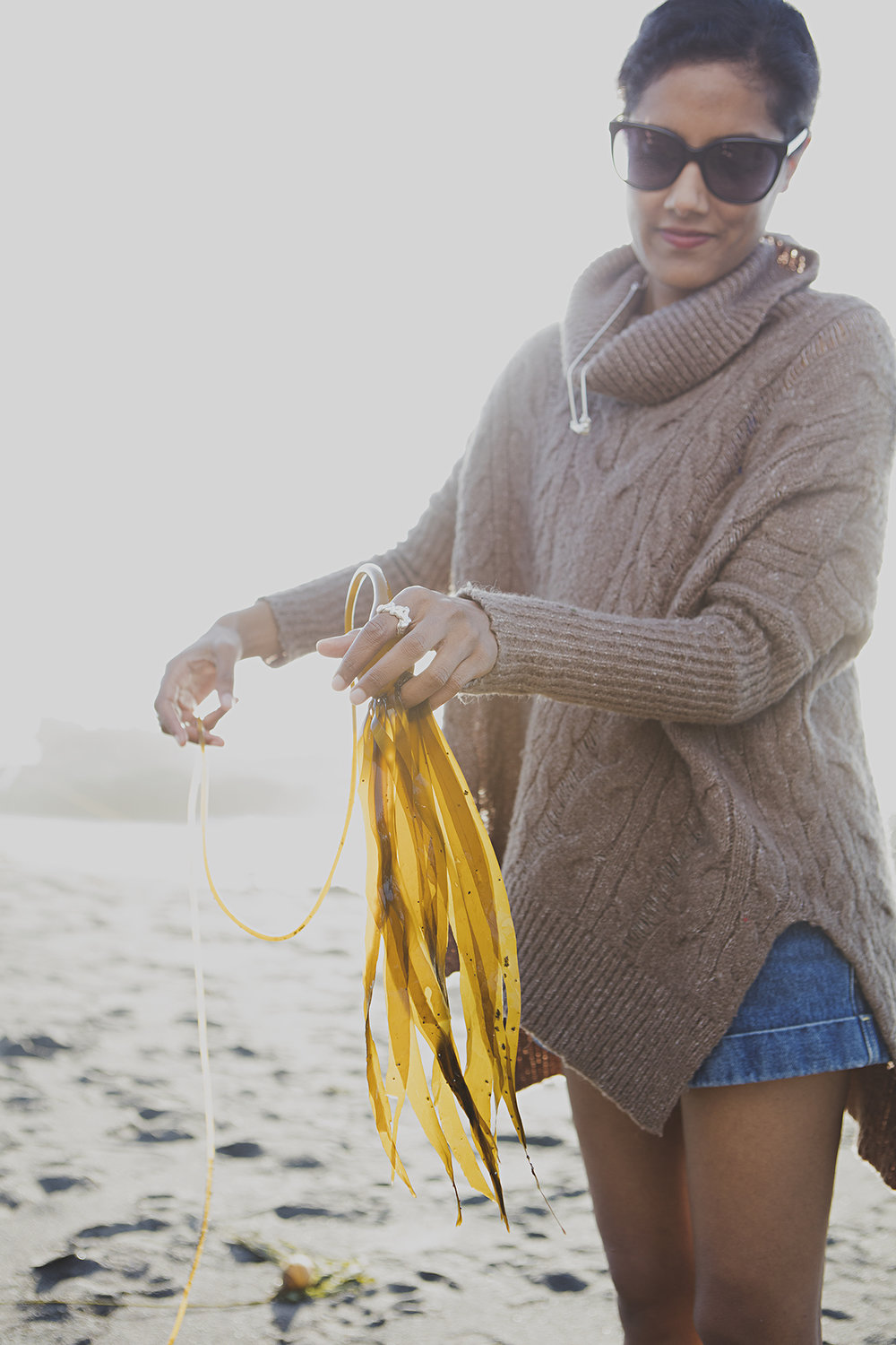 Shilpi researching seaweed in Mendocino wearing the  Alex Ring  and  Dylan Necklace