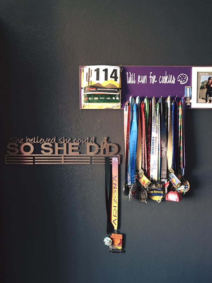 Aaaannd there she sits, my little heifer medal, on my newest medal rack... which is anxiously awaiting its next medal......
