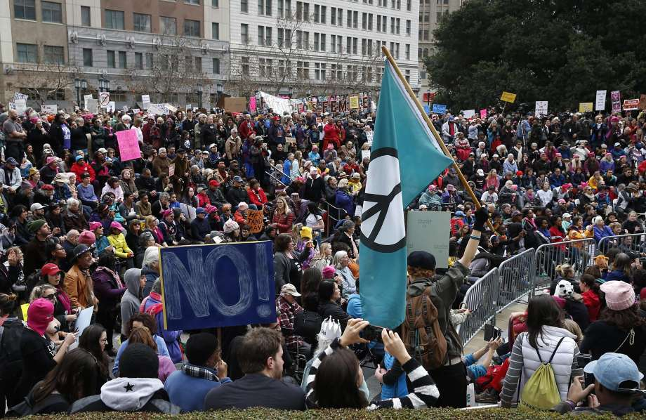 Photo: Paul Chinn, The Chronicle - Thousands gather in Frank Ogawa Plaza for a rally held after the Women's March in Oakland. Local businesses applauded the daytime protest as the right way to do things in Oakland.