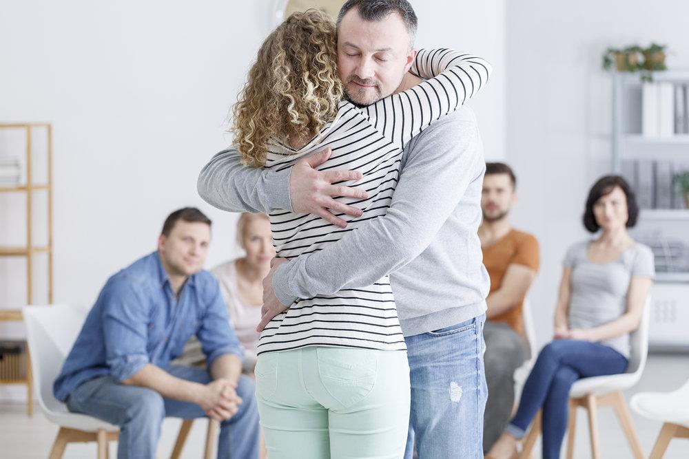 bigstock-Caucasian-Embracing-In-Room-203659384.jpg