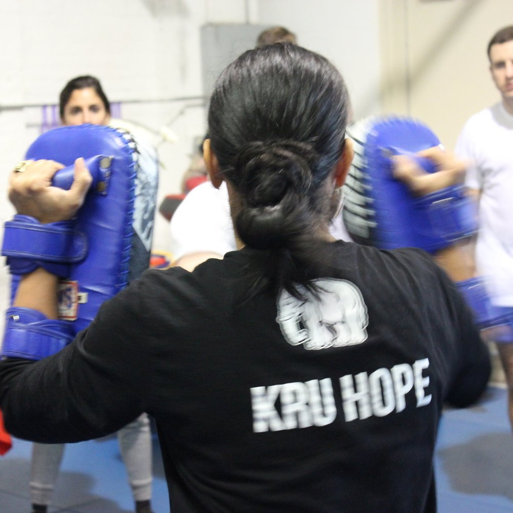 Testing Prep - Preparing to test is similar to preparing to fight.  Students train for several months at a heightened level, focusing on areas of opportunity in their Muay Thai and their personal fitness level.  Preparing also applies to life outside of the gym.  Students modify their diet, alcohol intake and sleep to ensure they are at their best on testing day.  Training testers wear solid-colored sashes for several months before testing.  The sashes are the color of the shorts they are preparing to earn and are worn to each class until they have tested.