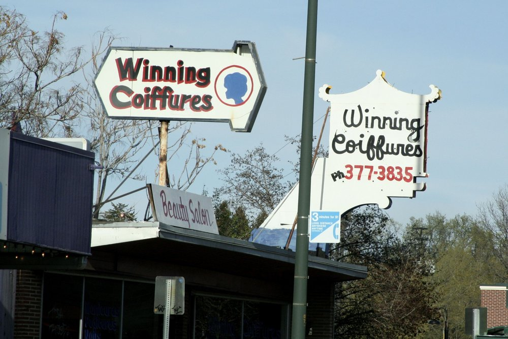 Best. Salon name. Ever. Those two repurposed signs atop the same building are priceless. Talk about consistent branding.