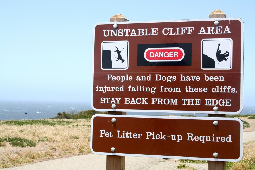 Say your dog is a cliff-shitter. What then? Look at it from that angle, and the two directives seem rather incompatible. Like someone out there wants us to fail—or at least, die trying.