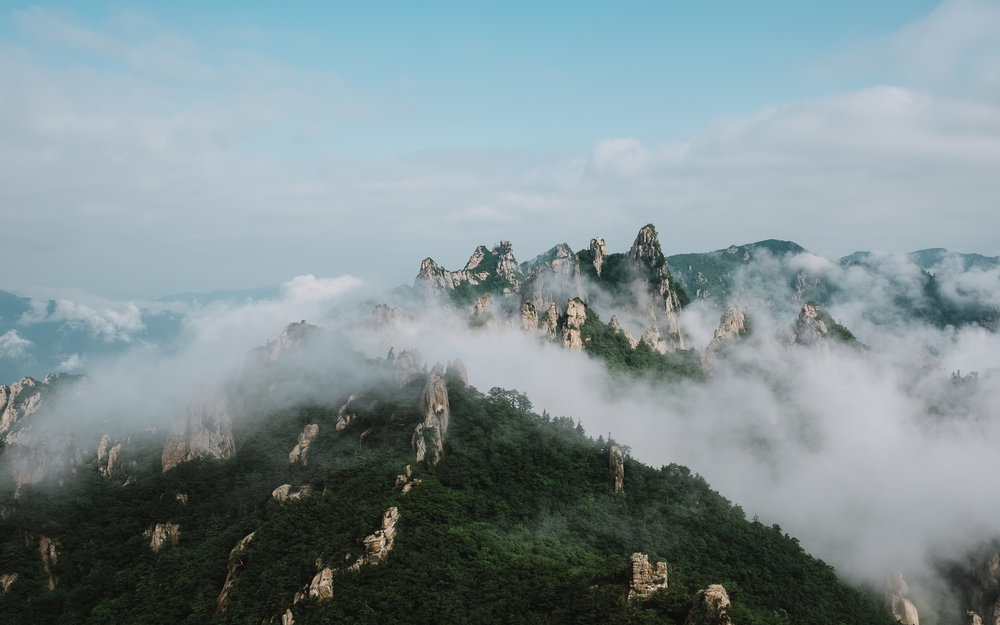 A foggy morning revealed this beautiful landscape of dinosaur ridge in Seoraksan, South Korea. I love camping out in the wilderness and exploring new areas.