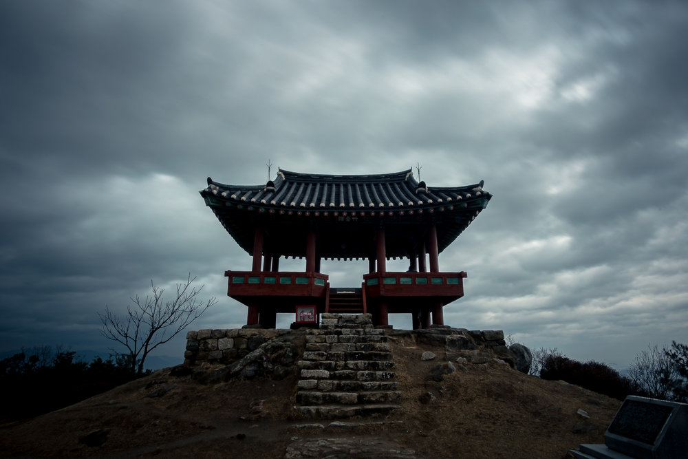 A beautiful Pagoda on top of a mountain over looks a city I once called home. These are pretty popular in Asia and in Korea specifically.