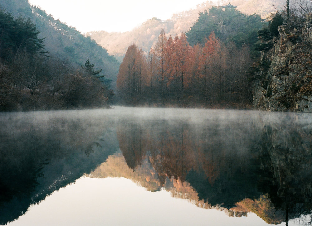 A beautiful lake reflection shot, late in the autumn morning. It is really rare to see such beautiful mist rising off the lake like this.  This was shot on my medium format film camera.